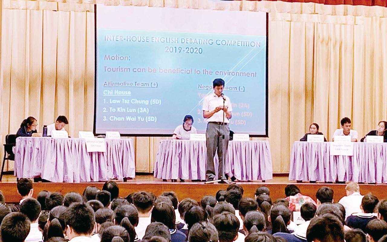 社際英語辯論比賽由高年級帶領低年級同學組隊,透過活動使各人英語水平得以急速提升。